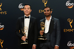 September 18, 2016 - Los Angeles, California, United States - Alan Yang and Aziz Ansari who won the Emmy Award for Outstanding Writing for a Comedy Series, pose backstage at the 68th Annual Emmy Awards at the Microsoft Theater in Los Angeles, California on Sunday, September 18, 2016. (Credit Image: © Michael Owen Baker/Los Angeles Daily News via ZUMA Wire)