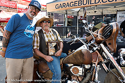 MC Jason Hallman of Torque Magazine and Bob Invester with his hide covered 1999 Suzuki Intruder that won the Radical Bagger class in the Dennis Kirk Garage Build bike show at the Iron Horse Saloon during the Sturgis Motorcycle Rally. SD, USA. Tuesday, August 10, 2021. Photography ©2021 Michael Lichter.