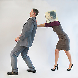 Businessman being pushed by businesswoman wearing mask