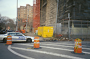 NYPD car driving by a construction site