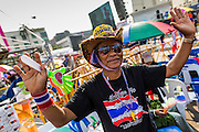 """29 DECEMBER 2013 - BANGKOK, THAILAND: An anti-government protestor at Democracy Monument in the old part of Bangkok to protest the ruling Pheu Thai party. Protest leader and former Deputy Prime Minister Suthep Thaugsuban announced an all-out drive to eradicate the """"Thaksin regime."""" The anti-government protesters have vowed to continue their protests even though the government has been dissolved and new elections called for in February.           PHOTO BY JACK KURTZ"""