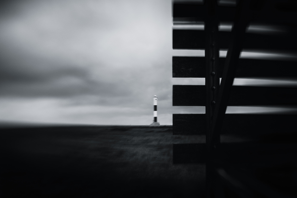 Shipping marker and lighthouse, Dungeness, UK