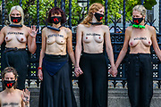 Climate activists who locked themselves topless against the railings of the Houses of Parliament, during an Extinction Rebellion (XR) protest, in London on Thursday, Sept. 10, 2020. Environmental nonviolent activists group Extinction Rebellion enters its 10th and final day of continuous ten days protests to disrupt political institutions throughout peaceful actions swarming central London into a standoff, demanding that central government obeys and delivers Climate Emergency bill. (VXP Photo/ Vudi Xhymshiti)