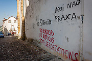 Political messages and graffiti saying No Borders, No Nations and to Stop Departations adorn walls on a street near Coimbra University, on 17th July, at Coimbra, Portugal.