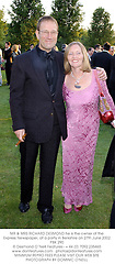 MR & MRS RICHARD DESMOND he is the owner of the Express Newspaper, at a party in Berkshire on 27th June 2002.PBK 290
