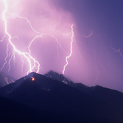 Montana lightning storm starts a hillside on fire in the Mission Valley near Ronan, Montana during the summer.