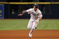 April 18, 2018 - St. Petersburg, FL, U.S. - ST. PETERSBURG, FL - APR 18: Carlos Gomez (27) of the Rays goes from first to third on the hit and goes head first safely into third base during the MLB regular season game between the Texas Rangers and the Tampa Bay Rays on April 18, 2018, at Tropicana Field in St. Petersburg, FL. (Photo by Cliff Welch/Icon Sportswire) (Credit Image: © Cliff Welch/Icon SMI via ZUMA Press)