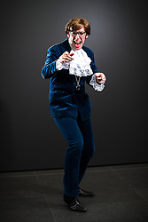 © Licensed to London News Pictures . 26/07/2015 . Manchester , UK . Portrait : AUSTIN POWERS ( Chris Stone , 31 , from Stoke-on-Trent ) at the venue . Comic Con convention at Manchester Central Convention Centre . Photo credit : Joel Goodman/LNP
