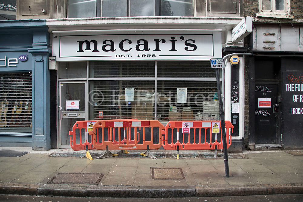 Closed down Macaris music and guiltar shop on Denmark Street, London, United Kingdom. Also known as Tin Pan Alley, this is the most famous place for musical instruments in the city, but is slowly losing its guitar shops as rents increase in the area.