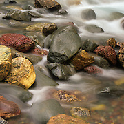 Colorful stream bed at the foot of Baring Falls in Glacier National Park, Montana.
