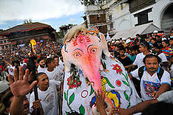 September 15, 2016 - Kathmandu, Nepal - Relic of Lord Ganesh carried dancing in the ritual tunes on the third day of Indra Jatra Festival celebrated at Basantapur Durbar Square, Kathmandu. Devotees celebrated the god of rain 'Indra' for 8 days in Kathmandu. (Credit Image: © Narayan Maharjan/Pacific Press via ZUMA Wire)