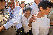 03 FEBRUARY 2013 - PHNOM PENH, CAMBODIA:  Cambodians push their way into the National Museum, site of former King Norodom Sihanouk's crematorium, to pay final respects to their former King. Sihanouk ruled Cambodia from independence in 1953 until he was overthrown by a military coup in 1970. The only music being played publicly is classical Khmer music. Sihanouk died in Beijing, China, in October 2012 and will be cremated during a state funeral royal ceremony on Monday, Feb. 4.    PHOTO BY JACK KURTZ