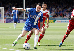 Peterborough United's Lee Tomlin in action with Swindon Town's Massimo Luongo - Photo mandatory by-line: Joe Dent/JMP - Tel: Mobile: 07966 386802 03/08/2013 - SPORT - FOOTBALL -  London Road Stadium - Peterborough -  Peterborough United v Swindon Town - Sky Bet One