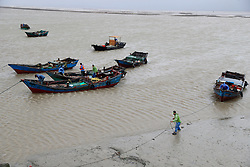 July 31, 2017 - Fuqing, China -  Fishermen reinforce fishing boats at a dock on Dongbi island in Longtian Township of Fuqing City, southeast China's Fujian Province. Typhoon Haitang, the 10th typhoon this year, landed at 2:50 a.m. Monday in Fuqing City.  The tropical cyclone followed typhoon Nesat, the ninth this year, which landed in the same city at 6 a.m. Sunday, according to the provincial meteorological observatory. The two typhoons brought heavy rainstorms to the province, with rainfall exceeding 50 mm in 64 counties, cities or districts over the past 24 hours as of 6 a.m. Monday. (Credit Image: © Jiang Kehong/Xinhua via ZUMA Wire)