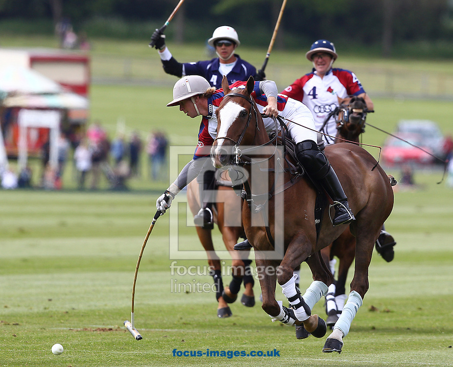 Picture by Paul Terry/Focus Images Ltd +44 7545 642257.18/05/2013 .James Beim of England breaks away during the St Regis International Polo match at Cowdray Park, Midhurst.