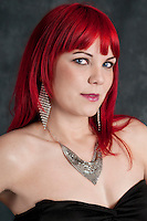 Portrait of young red-hair woman looking at camera very sensual.