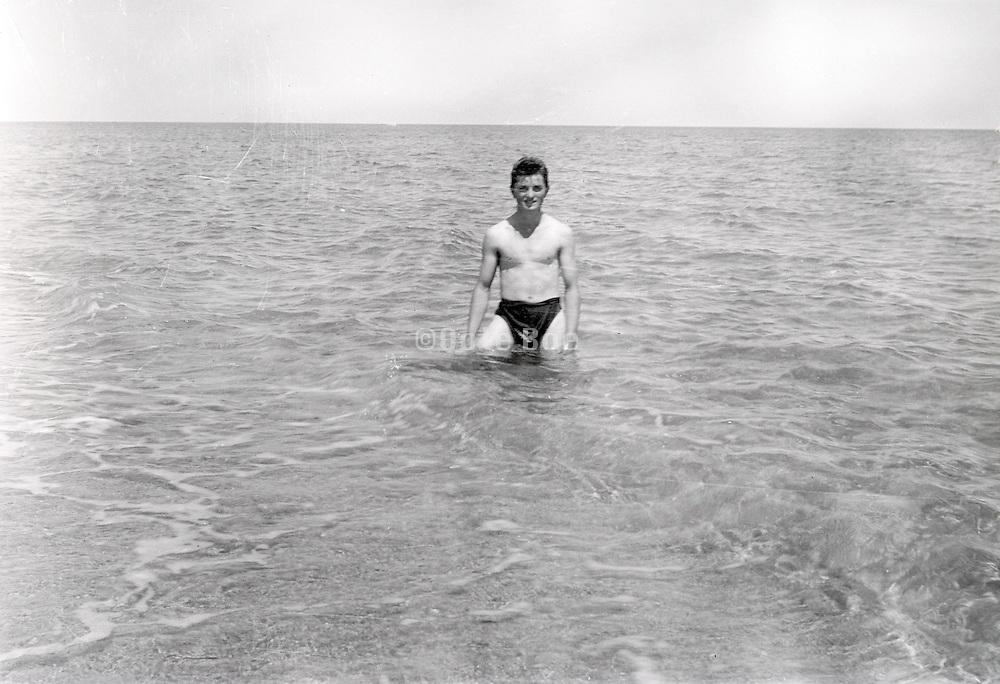 man posing in the sea 1950s