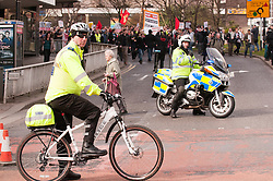 Police cyclist leads the Anti Cuts march during the Liberal Democrats conference in Sheffield