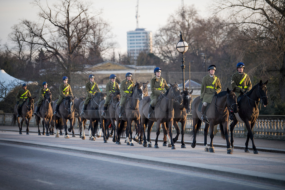 © Licensed to London News Pictures. 13/02/2021. London, UK. Members of the Household Cavalry exercise their horses at first light in Hyde Park in central London, following another night of sub zero temperatures in the capital. Photo credit: Ben Cawthra/LNP