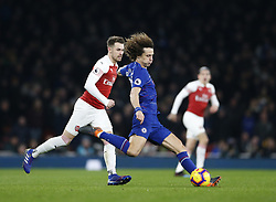 BRITAIN-LONDON-FOOTBALL-PREMIER LEAGUE-ARSENAL VS CHELSEA.(190120) -- LONDON, Jan. 20, 2019  Chelsea's David Luiz (C) clears the ball watched by Arsenal's Aaron Ramsey during the English Premier League match between Arsenal and Chelsea at the Emirates Stadium in London, Britain on Jan. 19, 2019. Arsenal won 2-0.  FOR EDITORIAL USE ONLY. NOT FOR SALE FOR MARKETING OR ADVERTISING CAMPAIGNS. NO USE WITH UNAUTHORIZED AUDIO, VIDEO, DATA, FIXTURE LISTS, CLUB/LEAGUE LOGOS OR ''LIVE'' SERVICES. ONLINE IN-MATCH USE LIMITED TO 45 IMAGES, NO VIDEO EMULATION. NO USE IN BETTING, GAMES OR SINGLE CLUB/LEAGUE/PLAYER PUBLICATIONS. (Credit Image: © Matthew Impey/Xinhua via ZUMA Wire)