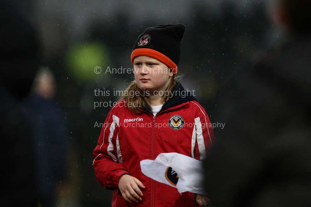 A young mascot waits for the teams to emerge for the start of the match. Skybet football league two match, Newport County v Plymouth Argyle at Rodney Parade in Newport, South Wales on Boxing Day, Friday 26th December 2014<br /> pic by Mark Hawkins, Andrew Orchard sports photography.