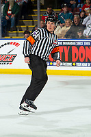 KELOWNA, BC - DECEMBER 18: Referee Fraser Lawrence skates on the ice at the Kelowna Rockets against the Vancouver Giants  at Prospera Place on December 18, 2019 in Kelowna, Canada. (Photo by Marissa Baecker/Shoot the Breeze)