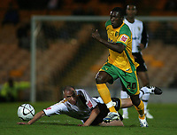 Photo: Paul Thomas.<br /> Port Vale v Norwich City. Carling Cup. 24/10/2006.<br /> <br /> Dickson Etuhu (R) of Norwich gets past the sliding tackle of Richard Walker.