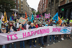 Environmental activists from Extinction Rebellion march from Trafalgar Square during the first day of Impossible Rebellion protests on 23rd August 2021 in London, United Kingdom. Extinction Rebellion are calling on the UK government to cease all new fossil fuel investment with immediate effect. (photo by Mark Kerrison/In Pictures via Getty Images)