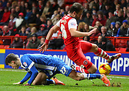 27. Solly March tackling 18. Simon Church during the Sky Bet Championship match between Charlton Athletic and Brighton and Hove Albion at The Valley, London, England on 10 January 2015. Photo by Matthew Redman.