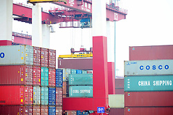 July 30, 2017 - Qingdao, Qingdao, China - Qingdao, CHINA-July 30 2017: (EDITORIAL USE ONLY. CHINA OUT) A ship loads containers at a terminal in Qingdao, east China's Shandong Province, July 30th, 2017. (Credit Image: © SIPA Asia via ZUMA Wire)