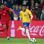 Turkey's Bekir Irtegun (L) and Brazil's Neymar JR (R) during their a international friendly soccer match Turkey betwen Brazil at Sukru Saracoglu Arena in istanbul November 12, 2014. Photo by Aykut AKICI/TURKPIX