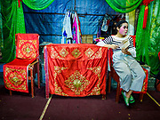 26 AUGUST 2018 - GEORGE TOWN, PENANG, MALAYSIA: A performer relaxes on stage before a Hokkien style Chinese opera on the Lim Jetty in George Town for the Hungry Ghost Festival. The opera troupe came to George Town from Fujian province in China. The Hungry Ghost Festival is a traditional Buddhist and Taoist festival held in Chinese communities throughout Asia. The Ghost Festival, also called Ghost Day, is on the 15th night of the seventh month (25 August in 2018). During the Hungry Ghost Festival, the deceased are believed to visit the living. In many Chinese communities, there are Chinese operas and puppet shows and elaborate banquets are staged to appease the ghosts.     PHOTO BY JACK KURTZ