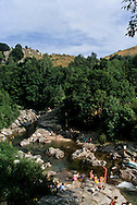 people bathing in a river in Pont de Montvert area Cevennes. landscape  Tarn river Canyon