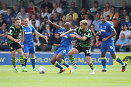 AFC Wimbledon midfielder Jimmy Abdou (8) battles for possession with Doncaster Rovers midfielder James Coppinger (26) during the EFL Sky Bet League 1 match between AFC Wimbledon and Doncaster Rovers at the Cherry Red Records Stadium, Kingston, England on 26 August 2017. Photo by Matthew Redman.