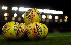 Footballs on the pitch before kick-off