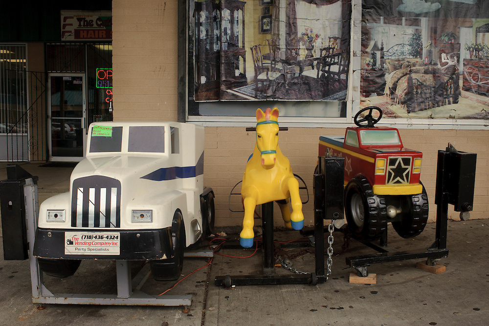 3 riding toys for kids stand outside a shopping mall in Brentwood. (July. 19, 2012)