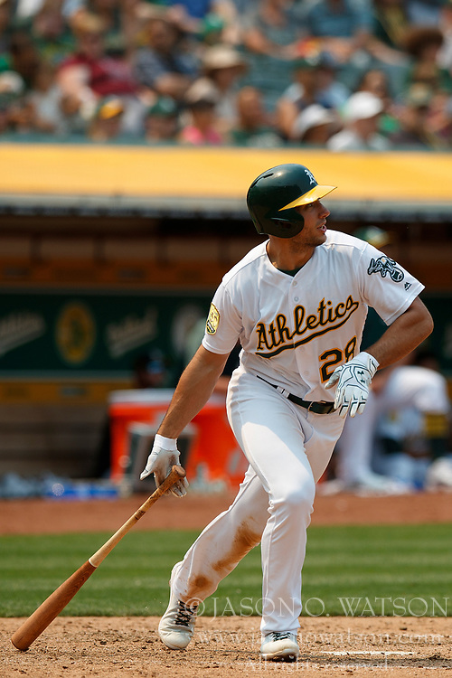 OAKLAND, CA - JULY 01: Matt Olson #28 of the Oakland Athletics at bat against the Cleveland Indians during the sixth inning at the Oakland Coliseum on July 1, 2018 in Oakland, California. The Cleveland Indians defeated the Oakland Athletics 15-3. (Photo by Jason O. Watson/Getty Images) *** Local Caption *** Matt Olson