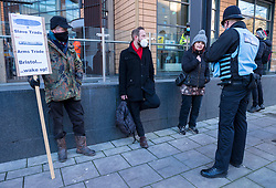© Licensed to London News Pictures; 25/01/2021; Bristol, UK. Colston Four at court. A protestor with an anti-slavery placard is arrested outside court. Defendants Rhian Graham, 29, Milo Ponsford, 25, Jake Skuse, 32, and Sage Willoughby, 21, are due before Bristol Magistrates' Court for their first hearing today. They have been charged with criminal damage in connection with damage to the statue of slave trader Edward Colston which was pulled down during a Black Lives Matter protest on June 7 2020 and then thrown into Bristol Harbour. Police launched an appeal to trace suspects after the event and ten people were located. Six people accepted a caution while four were referred to the CPS. The statue was later retrieved by Bristol City Council who say that the damage is costed at £3,750. Police have warned anyone planning to protest at the court hearing that they will be breaking the lockdown laws which prohibit public gatherings of more than two people to combat the Covid-19 coronavirus pandemic. Photo credit: Simon Chapman/LNP.