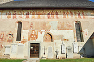 """Exterior of the Church of San Vigilio in Pinzolo and its fresco paintings """"Dance of Death"""" painted by Simone Baschenis of Averaria in1539, Pinzolo, Trentino, Italy ..<br /> <br /> Visit our MEDIEVAL ART PHOTO COLLECTIONS for more   photos  to download or buy as prints https://funkystock.photoshelter.com/gallery-collection/Medieval-Middle-Ages-Art-Artefacts-Antiquities-Pictures-Images-of/C0000YpKXiAHnG2k<br /> <br /> If you prefer to buy from our ALAMY PHOTO LIBRARY  Collection visit : https://www.alamy.com/portfolio/paul-williams-funkystock/san-vigilio-pinzolo-dance-of-death.html ."""