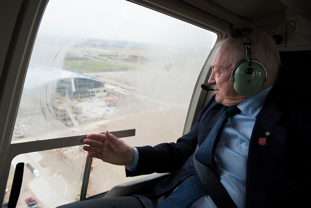 Dallas Cowboys owner Jerry Jones looks out the window during a helicopter ride over his new team headquarters and practice facility in Frisco, Texas on December 1, 2015.  (Cooper Neill for The New York Times)