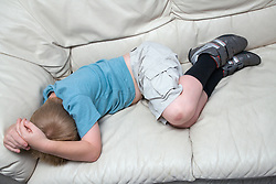 Little boy asleep on the sofa,