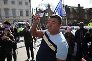 Pro Brexit protester shouts for Steve Bray, the anti Brexit protester to show his identification saying he is a fake  in Westminster as the Prime Minister arrives in Brussels to request an extension to Article 50 so the UK can continue to try to agree a Brexit Withdrawal Agreement on 10th April 2019 in London, England, United Kingdom. With just two days until the UK is supposed to be leaving the European Union, the delay decision awaits.