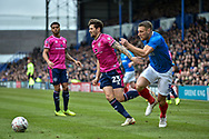 Queens Park Rangers Midfielder, Pawel Wszolek (23) holds off Portsmouth Defender, Lee Brown (3) during the The FA Cup fourth round match between Portsmouth and Queens Park Rangers at Fratton Park, Portsmouth, England on 26 January 2019.