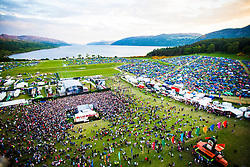 """Fatboy Slim plays the main stage, as seen from the Giant Wheel, on Saturday at Rockness 2013, the annual music festival which took place in Scotland at Clune Farm, Dores, on the banks of Loch Ness, near Inverness in the Scottish Highlands. The festival is known as """"the most beautiful festival in the world"""" ."""