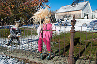 """Yes it may be """"too early"""" and nobody """"is ready"""" but Mother Nature along with this scarecrow girl and friends are enjoying the sparkle brought to the region after an early season snowfall last evening.  (Karen Bobotas/for the Laconia Daily Sun)"""