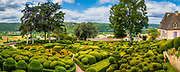 "The Gardens of Marqueyssac are located in the town of Vézac, in the French area of Dordogne, in the region of Nouvelle-Aquitaine. It is on the list of ""jardins remarquables de France"" (remarkable gardens in France). The park of Château de Marqueyssac is a private estate of twenty-two hectares built around an 18th century castle. Its facilities are typical of what was done in France under Napoleon III.<br /> <br /> Built on a rocky spur 130 meters above the river, the park offers a view of the valley, castles and nearby villages, including Beynac-et-Cazenac, Fayrac, Castelnaud, La Roque-Gageac and Domme.<br /> <br /> In 2011, it was the third most visited tourist site in the Dordogne with 190,000 visitors."