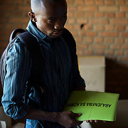 A member of Burundi's National Electoral Commission prepare the last details of the upcoming parliamentary elections, in a classroom to be used as a poling station in Cibitoke neighbourhood, Bujumbura, June 28th, 2015.