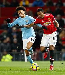 Manchester City's Leroy Sane (left) and Manchester United's Anthony Martial battle for the ball during the Premier League match at Old Trafford, Manchester.