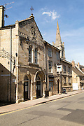 All Saints church spire and Old Fellows Hall,  Church Street, Stamford, Lincolnshire, England, UK