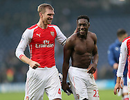 Arsenal's Danny Welbeck celebrates at the final whistle with Per Mertesacker<br /> <br /> Barclays Premier League- West Bromwich Albion vs Arsenal - The Hawthorns - England - 29th November 2014 - Picture David Klein/Sportimage